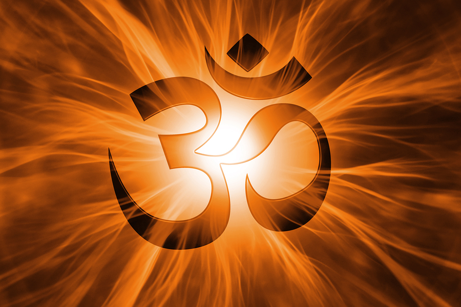 Illustration with mantra om sign surrounded by energy beams